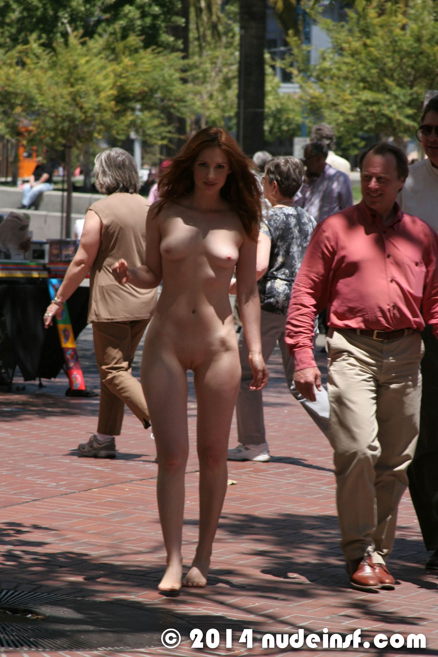 Girl walks the public streets totally naked
